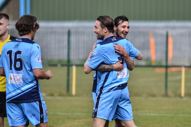 Conor Bailey (middle) is congratulated by Connor Hoare after scoring on his AFC Portchester debut at Hamble Club. Picture: Daniel Haswell.
