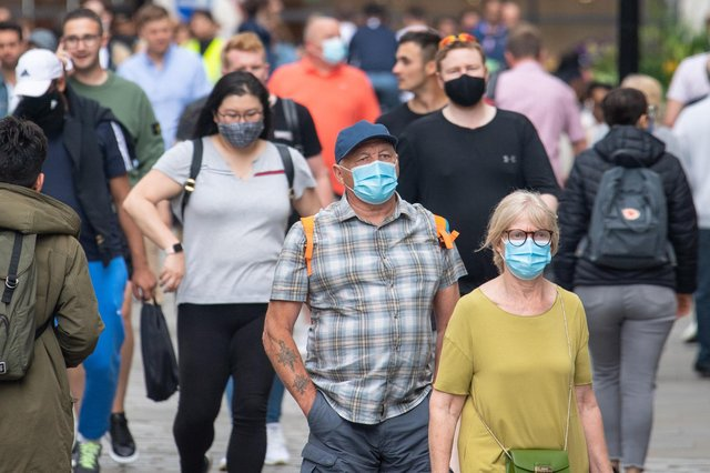 """People wearing face masks among crowds of pedestrians in Covent Garden, London.  during the easing of lockdown restrictions in England. Picture date: Sunday July 4, 2021. PA Photo. Rumours were abound in the Sunday newspapers that Prime Minister Boris Johnson, who is due to update the nation this week on plans for unlocking, is due to scrap social distancing and mask-wearing requirements on so-called """"Freedom Day"""". See PA story HEALTH Coronavirus. Photo credit should read: Dominic Lipinski/PA Wire"""