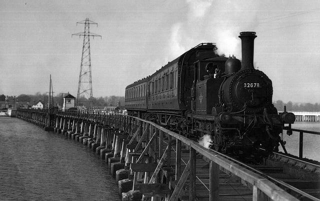 The Hayling Billy in her prime crossing Langstone trestle bridge.