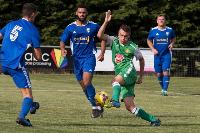 Ryan Pennery (green) in action for Moneyfields in the 2019/20 season. Picture: Duncan Shepherd