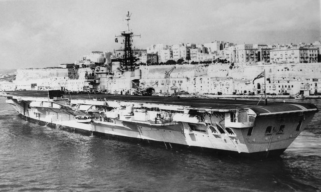 The Royal Navy Centaur class light fleet aircraft carrier HMS Hermes steams into the Grand Harbour of the Port of Valetta naval base on 20 March 1967 in Valetta, Malta.
