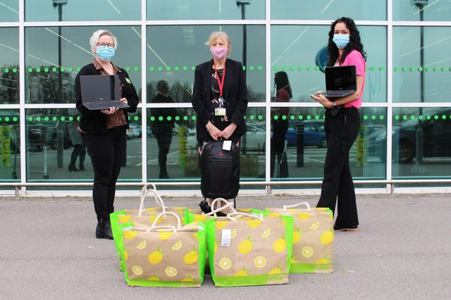From left: Sara Osborne, Susan Parish, and Katy Trapani, holding the equipment being donated by ASDA Havant to Park Community School. Picture: Emily Turner