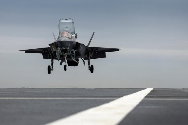 Pictured: British F35 of 207 Squadron RAF landing on HMS Prince of Wales for the first time. All photos by: LPhot Finn Hutchins