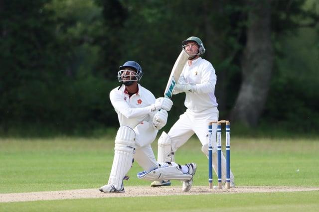 Havant batsman Richard Jerry skies a shot against Bournemouth. Picture: James Robinson