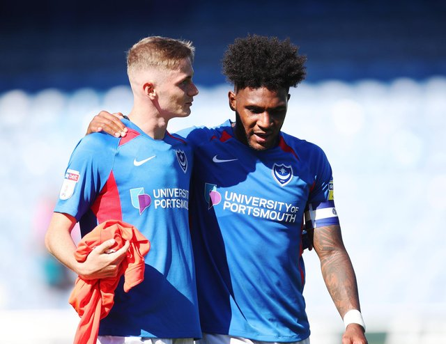 Former Pompey youngster Eoin Teggart is congratulated by team-mate Ellis Harrison after his debut against Norwich under-21s in the 2019-20 Checkatrade Trophy