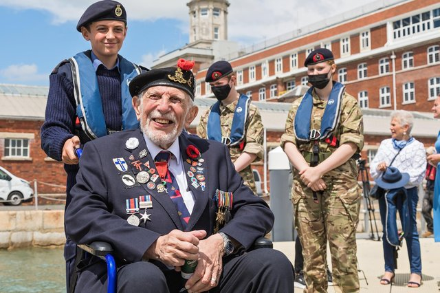 D-Day veteran Joe Cattini (98) escorted by Portsmouth Sea Cadet Hayden Temperton (13). Picture: Mike Cooter (250621)