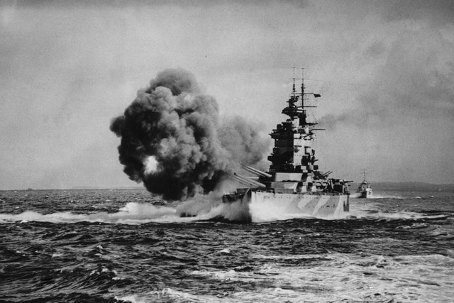 The Royal Navy Nelson-class battleship HMS Nelson, named after Horatio, fires a full broadside with her nine16-inch (406 mm) guns known as Happy, Grumpy, Sneezy, Dopey, Sleepy, Bashful, Doc, Mickey and Minnie after the characters in the film Snow White whilet on operations in the Mediterranean as part of Force H on August 1, 1942, in the Mediterranean near Gibraltar.  Picture: Keystone/Getty.
