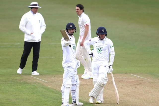 James Vince, left, celebrates reaching 150 next to Liam Dawson during day one of the LV= Insurance County Championship match at Grace Road. Photo by Alex Pantling/Getty Images.