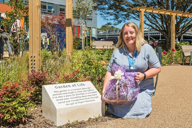 Amy Sheaff, 28, with the prize she received after her suggestion was used to name the Garden of Life at QA Hospital. Picture: Mike Cooter (090621)