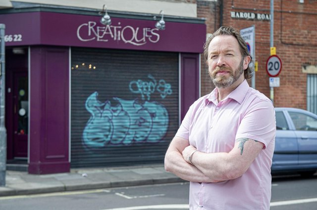 Creative director Rob Pearce outside Creatiques bridal boutique, Southsea with the graffiti on the shutters of his shop. Picture: Habibur Rahman