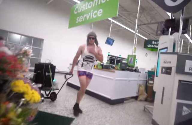 YouTube prankster Lee Marshall, 34, who goes by the name DiscoBoy on the streaming site has been convicted of assault by beating against an Asda supermarket night manager. Pictured:  Lee Marshall wearing shorts, a vest and a hat inside the Asda store