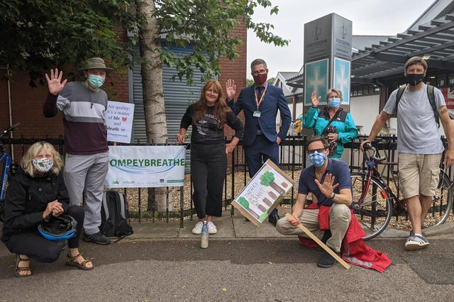 Members of the Let Pompey Breath campaign with councillor George Fielding (fourth from right) on Kingston Crescent before the group left for their walk. Picture: Emily Turner