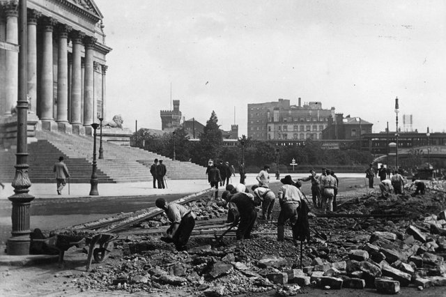 1902:  The laying of the electric track for Portsmouth trams, outside the town hall (later the Guildhall).  Picture: Hulton Archive/Getty Images.
