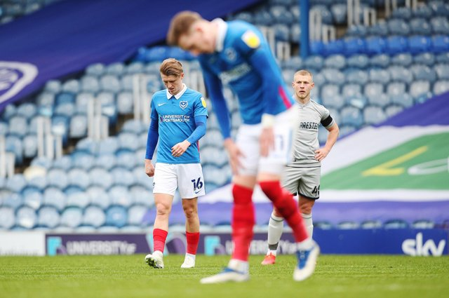 Ronan Curtis and George Byers are dejected following the 2-1 defeat to Burton at Fratton Park. Picture: Joe Pepler