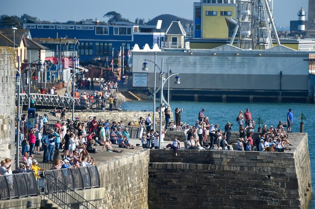 Crowds watch as HMS Queen Elizabeth departs from the Naval base on September 21, 2020 in Portsmouth. Picture: Finnbarr Webster/Getty Images