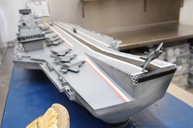 David Duncan and his staff at 3D Cakes at Roseburn, Edinburgh have created an 8ft scale replica cake of the HMS Queen Elizabeth which was driven down to Portsmouth today and presented to the Queen at the commissioning ceremony of the HMS Queen Elizabeth in 2017. Picture: Greg Macvean