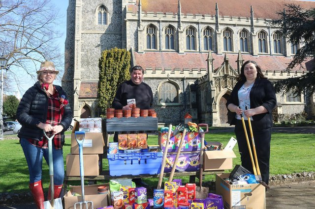 Mel Goddard, family services manager at the Roberts Centre, and Jo Eamey, business support and development director at Stop Domestic Abuse, receiving the Easter donations from Canon Bob White, vicar at St Mary's Church in Fratton