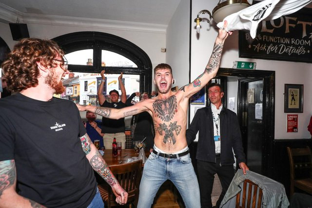 Fans pictured in The Kings pub celebrating as England score their first goal. Picture: Stuart Martin (220421-7042)