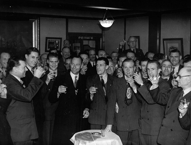 Pompey players and backroom staff celebrate the club's championship win at the end of the 1948-49 season with Tom Holland (with the moustache) in the centre at the back.
