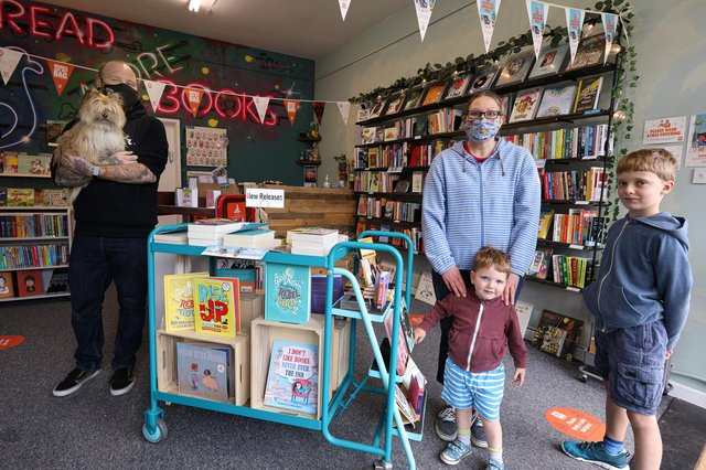 Co-owner Phil Davies with customers Laura Trowern and her children, Rupert, two, and Oscar, eight. Picture: Chris Moorhouse (jpns 190621-01)