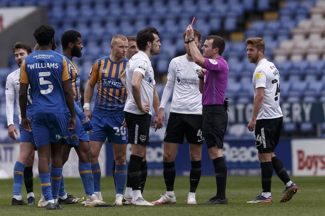 John Marquis is shown a red card today. (Photo by Daniel Chesterton/phcimages.com)