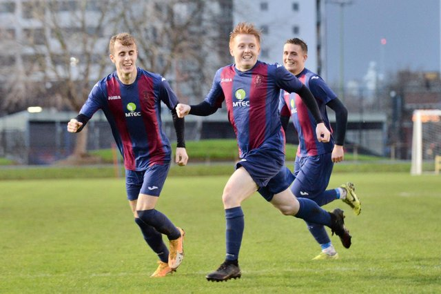 Frankie Paige (foreground) wheels away after scoring for US Portsmouth in their 3-2 Vase third round win over Millbrook in December. Pic: Martyn White.