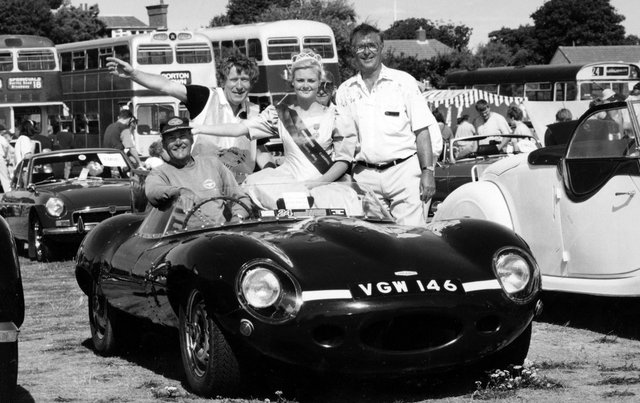 1958 d-type Jaguar replica owner Eric Ansell with Gosporteers rally chairman Pat Doran and carnival queen Clair Lee at Stokes Bay for the Gosport Carnival in 1995. The News PP5609