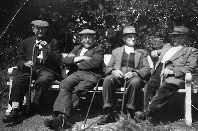 Last of the summer wine bench. From left:  Mr Carter, Mr Jerome, William Cooper and Mr Budd (Buddy). Mr Cooper and Mr Budd lived in Newtown. Picture: Courtesy of  Joan Brameld (nee Savage). Her grandfather was Mr Cooper.