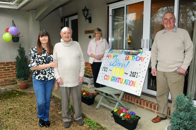Boris Mayfield from Denmead, celebrated his 100th birthday on Thursday, March 4. Pictured is: (l-r) Boris's niece Tracy Brown with Boris Mayfield and his neighbours Judy and David Clementson. Picture: Sarah Standing (040321-4129)