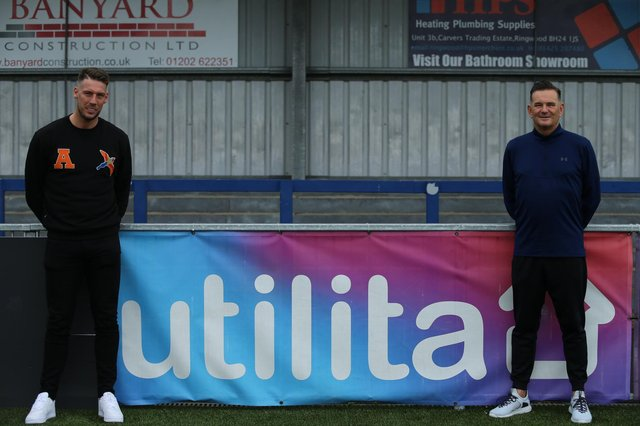 New signing Alex Wall, left, and Hawks boss Paul Doswell. Picture: Kieron Louloudis