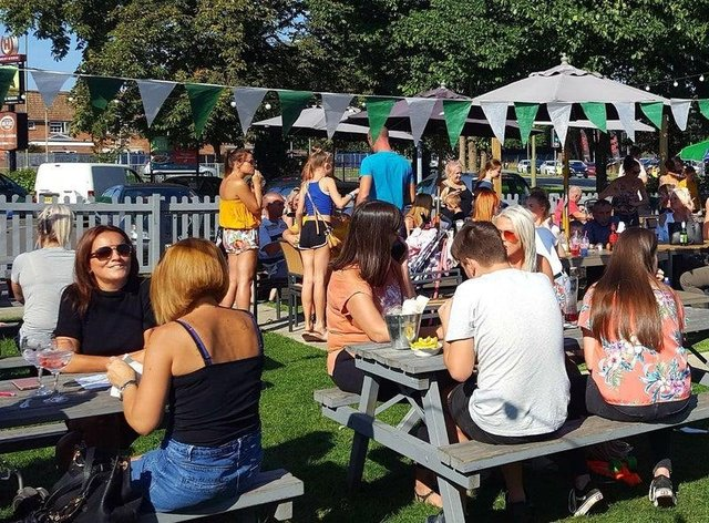 The Heron, in Havant, with customers enjoying its garden before the Covid-19 pandemic. Picture: Craig Cockram