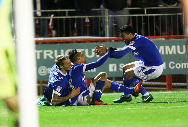 Danny Rose celebrates with goalscorer Kyle Bennett at Crawley in March 2017 - after the winger put Pompey on their way to the League Two title. Picture: Joe Pepler/Digital South
