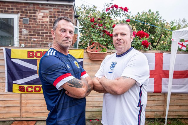Darren Archer and his father in law, Cliff Williams will be on opposite side of the fence during England and Scotland's clash at the Euros tomorrow.Pictured: Cliff Williams and Darren Archer at Darrens Home in Milton, Portsmouth on 17 June 2021Picture: Habibur Rahman