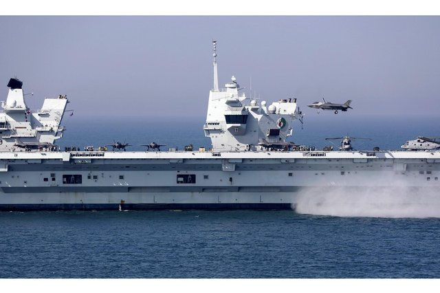 F-35B jets and Merlin Mk2 helicopters on the deck of HMS Queen Elizabeth during an exercise last year