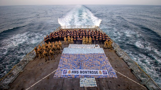 HMS Montrose's crew stand next to the £3m haul of seized drugs. Photo: Royal Navy