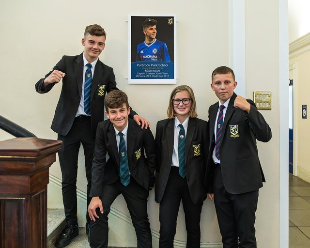 Ben Saunders, Harvey Bates, Alice Jacknelle and Albert-Lee Garrett (all 14) show a gesture of support for Mason Mount, a former pupil at Purbrook Park School. Picture: Mike Cooter (090721)