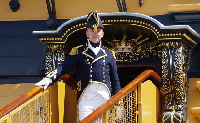 Captain Hardy welcomes visitors aboard HMS Victory at Portsmouth Historic Dockyard