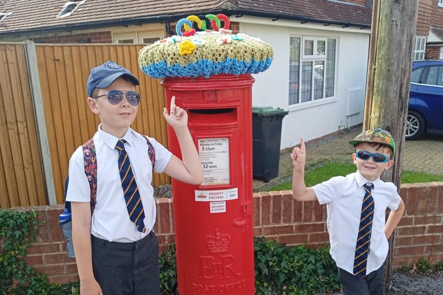 Thomas Smith, nine, and Noah Smith, five, with the postbox on the corner of Parkside and Queen Anne's Drive