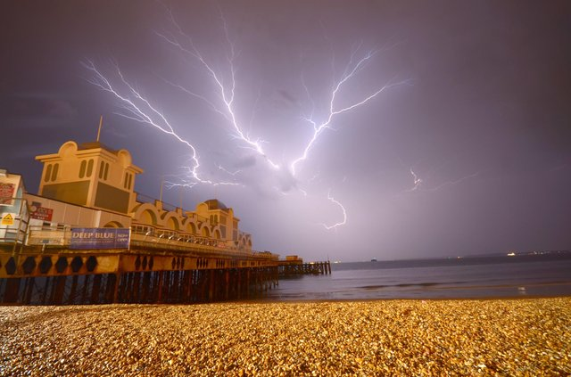 Lightning striking behind South Parade Pier. Picture: Tony Wallace