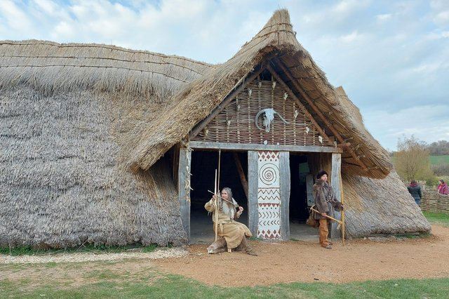 Butser Ancient Farm's reconstruction of a stone age building, Horton House, unveiled, April 2021. From left: Jo Shorter, William Scanlan.  Picture by Chris Broom