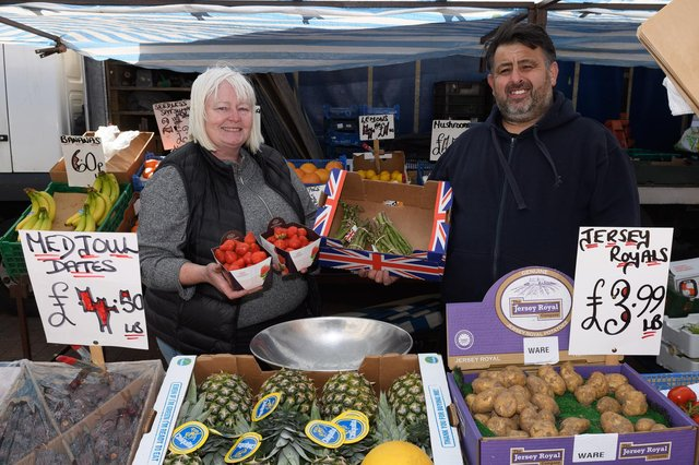 Pictured is: Sandy and Perry who have run Leon's fruit and veg market stall for the 25 years. Picture: Keith Woodland (240421-2)