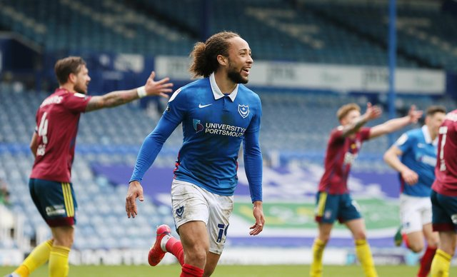 Marcus Harness celebrates his first goal since October - and  Pompey's winner - against Ipswich. Picture: Joe Pepler