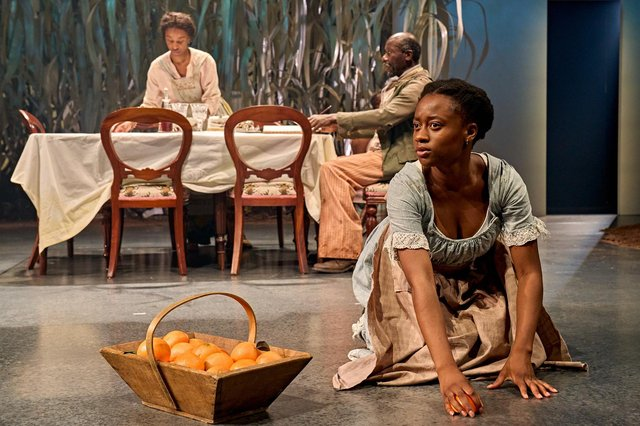 Tara Tijani (centre, as July), Perola Congo and Trevor Laird in The Long Song at Chichester Festival Theatre. Photo by Manuel Harlan