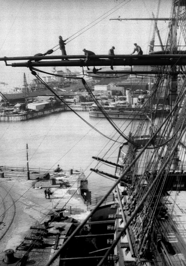April 20, 1934:  Riggers at work on Nelson's flagship, HMS Victory in Portsmouth dockyard. She was re-rigged every five years and would be ready in time for Navy Week when thousands of visitors would look around her. Picture: Getty.