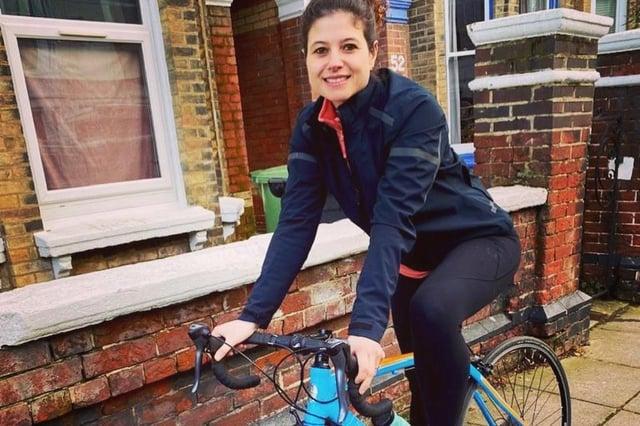 Cllr Charlotte Gerada on a bicycle.