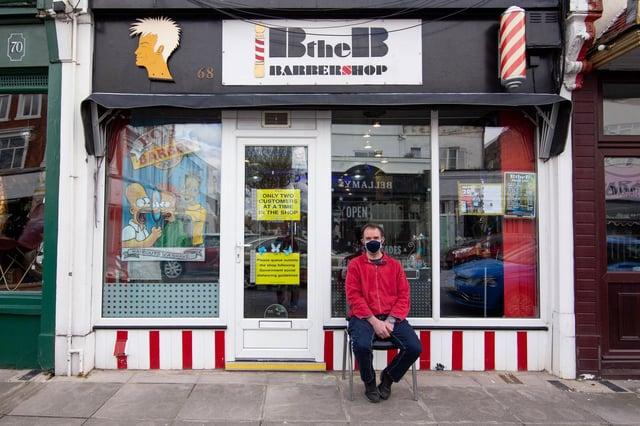Mike Yeoman waiting to get his haircut outside Bob the Barbershop, Albert Road. Picture: Habibur Rahman