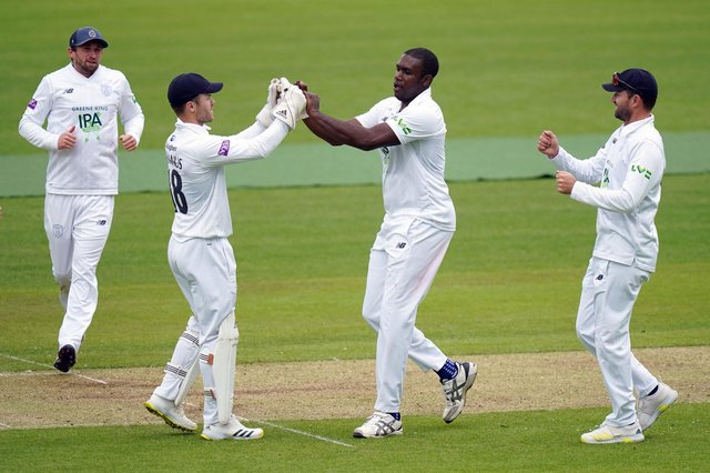Hampshire's Keith Barker (centre) celebrates taking the wicket of Middlesex's Martin Anderson at Lord's yesterday. Picture: Adam Davy/PA Wire.