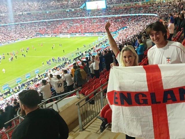Caroline Dinenage, Gosport MP, celebrates England's victory over Denmark at Wembley.`