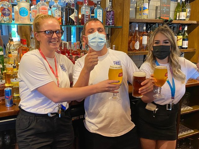 From left, team leader Harley O'Brien, manager Roy Wolstenholme and team leader Trish Ionescu at the Portsbridge pub in Cosham this afternoon ahead of the England-Denmark Euro 2020 semi-final  Picture: Tom Cotterill