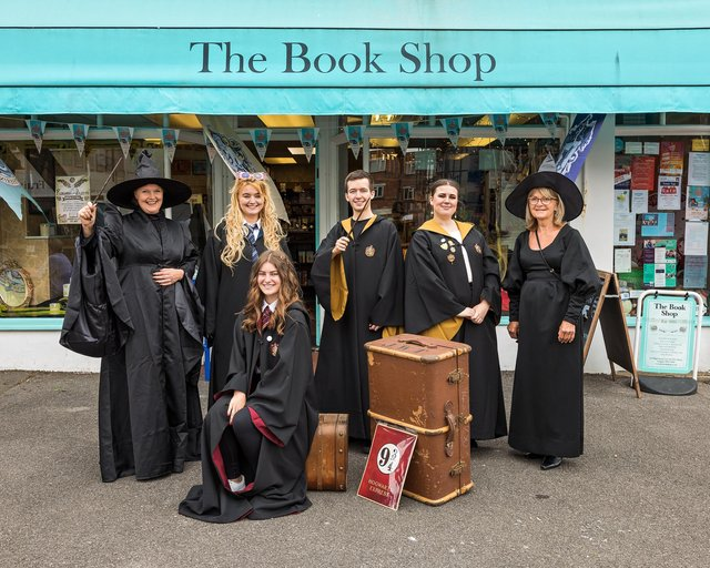 Sarah Veal (48), Jazmine Woodward (22), Kieran Slade (18), Shania Erdman (24), Barbara Veal (74) and Jessica Elshaw (16, seated) prepare for Harry Potter night outside of the outside of The Book Shop in Lee-On-The-Solent. Picture: Mike Cooter (240621)